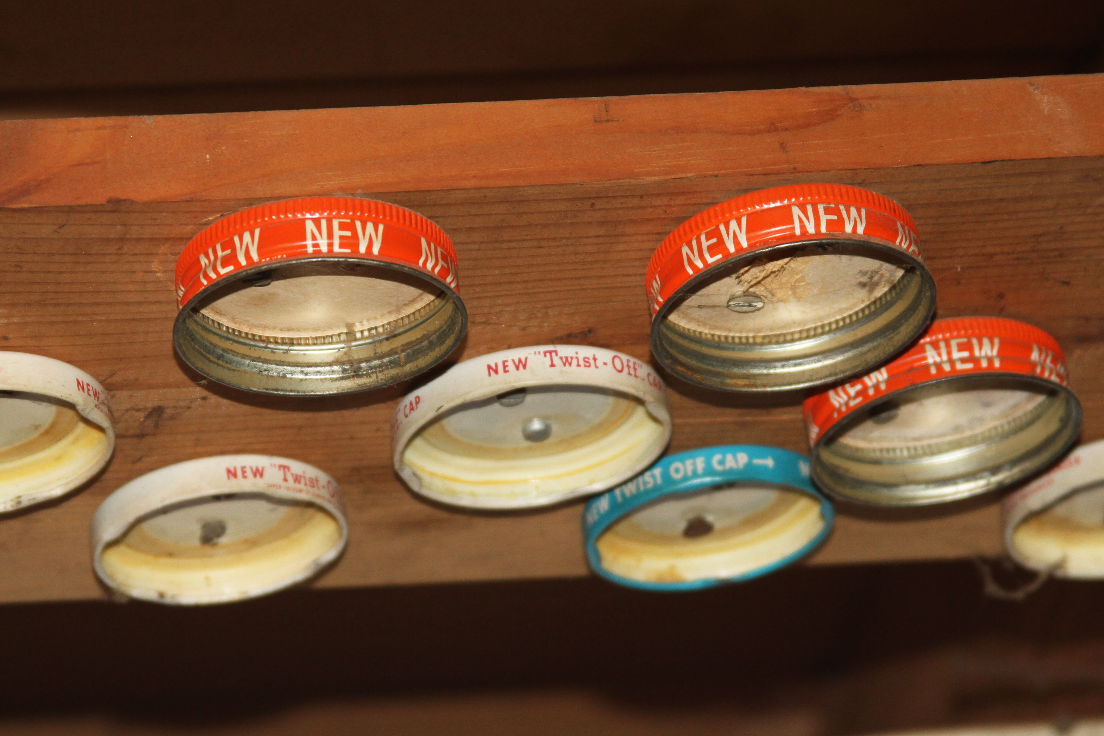 An Innovation from my past.  Some may call it a board with jar lids attached.  I call it the ceiling tool bench organizer.  Simply fill jars with items like nails or screws and attach jars to the appropriate lid.  Voila - organized and stored.